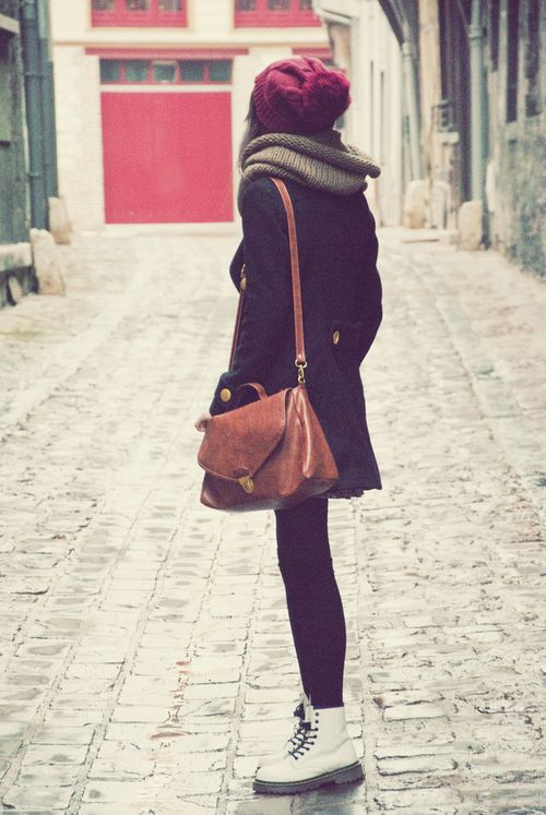 white docs, brown leather satchel and red beanie. this looks just like me! (not me of course) but it does haha