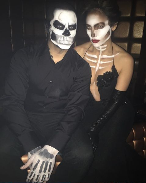 "Jennifer Lopez became a ""couture"" skeleton while her beau Casper Smart wore a matching look. #refinery29 http://www.refinery29.com/2015/10/96704/best-celebrity-halloween-costumes-2015#slide-3"