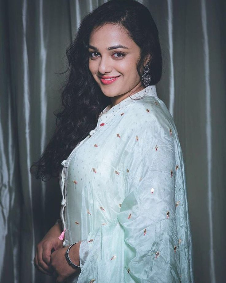 Nithya Menon looks insanely flattering at the audio launch of Telugu dubbed version of Malayalam super hit movie '100 days of love'. The actress was wearing a Picchika by Urvashi Sethi's pastel mint salwar suit teamed with a taby silk dupatta which features hand embroidered boota's all over. To spice up the look she accessorized …