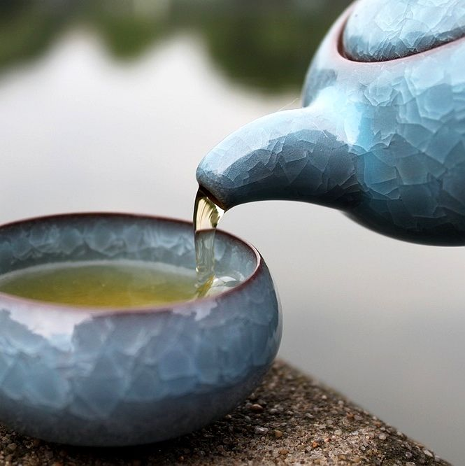 Material: Natural sand clay with light blue colored ice crack, glazed and fired to 2175 degrees.    Measurement: teapot - 17cm x 15cm x 7cm . Capacity: 160ml      Teacup - 60ml