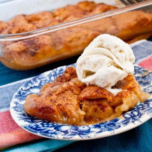 Easiest Apple Dumplings Of Your Life - You'll never need another recipe for apple dumplings again after trying this one. The dumplings are perfectly crispy on top with a warm and gooey filling. These give you a little taste of fall in the summer!