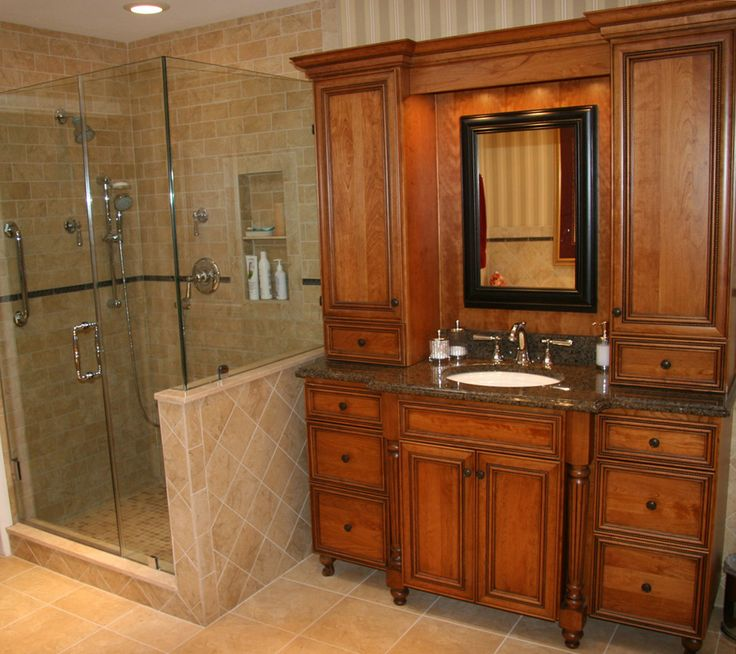 Digital Art Gallery This traditional bathroom features tan walls and beech wood cabinets with plenty of storage space