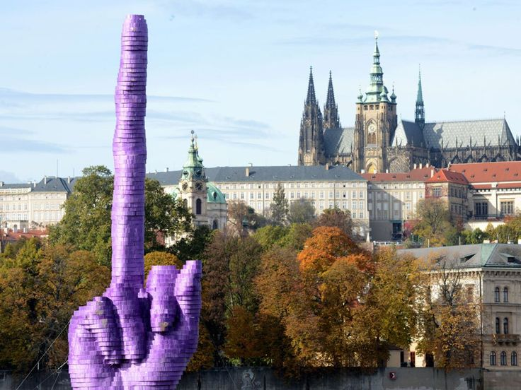 Czech artist lets socialist president know how he feels with giant middle finger inPrague