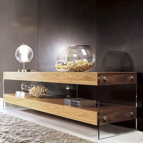 Warm-toned walnut veneer makes this atypical TV stand a standout in the family room. The lower shelf is a wide-open space for blu-ray players and gaming consoles, bounded by clear glass sides that make the whole thing look like it's floating.