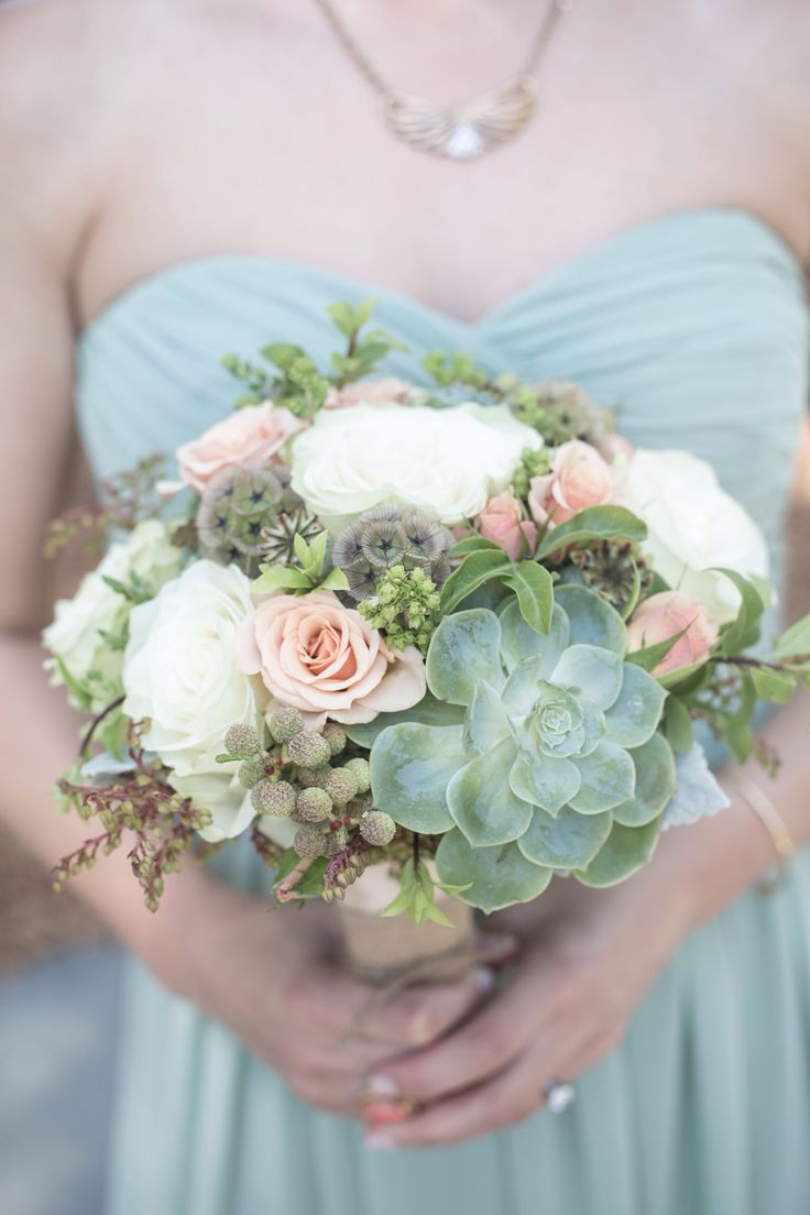 Love the shape and texture! Succulents, a few brunia berries, two types of roses, greens and seed pods)