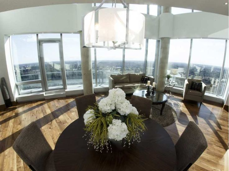 the dining and sitting room are seen inside the penthouse suite of the pearl tower in - Home Decor Edmonton