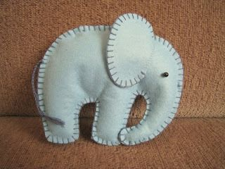 just bought some felt and things to make a little elephant mobile for baby :D