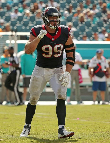 J.J. Watt Photos Photos - J.J. Watt #99 of the Houston Texans reacts to a sack during a game against the Miami Dolphins at Sun Life Stadium on October 25, 2015 in Miami Gardens, Florida. - Houston Texans v Miami Dolphins