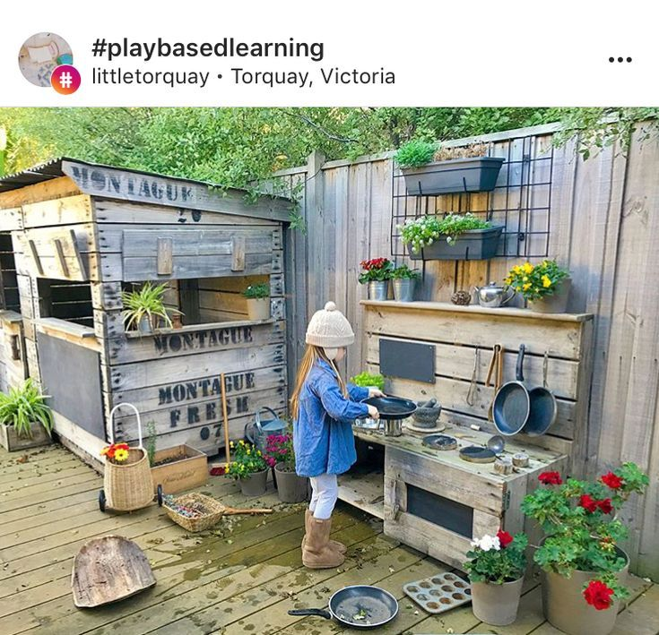 Outdoor mud kitchen and playhouse. Rustic.