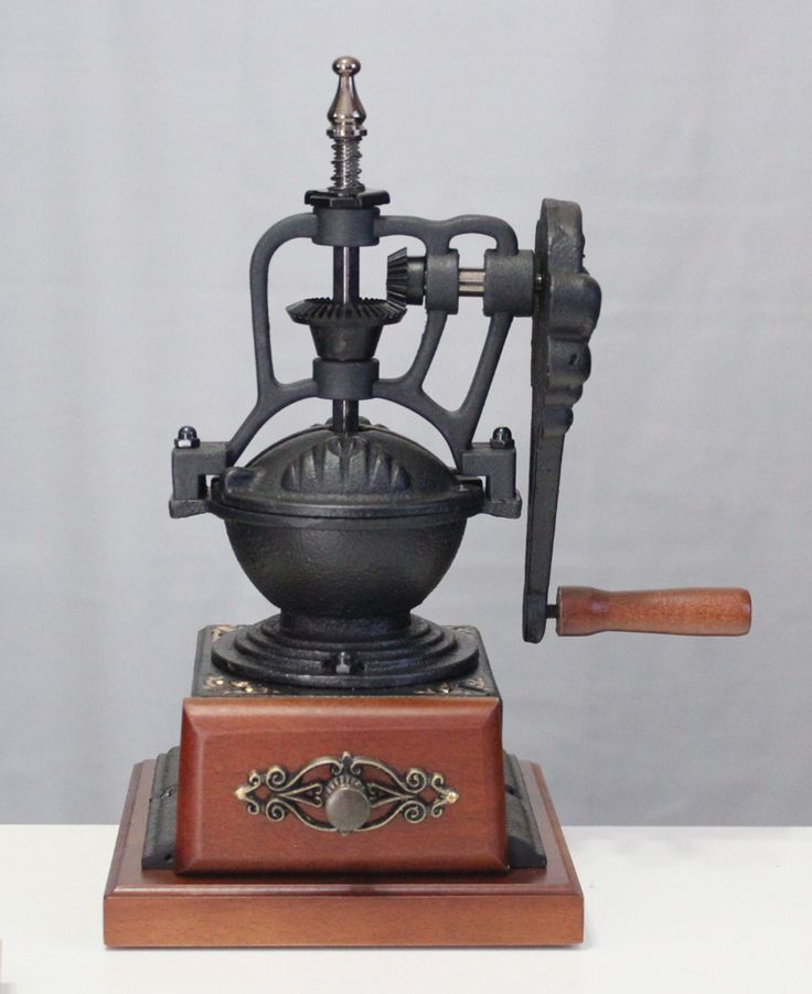 """Antique style manual coffee bean grinder Black cast iron with hand crank, wood base & collecting box. Extremely sharp ceramic grinder core 10"""" H, 5.25lbs"""