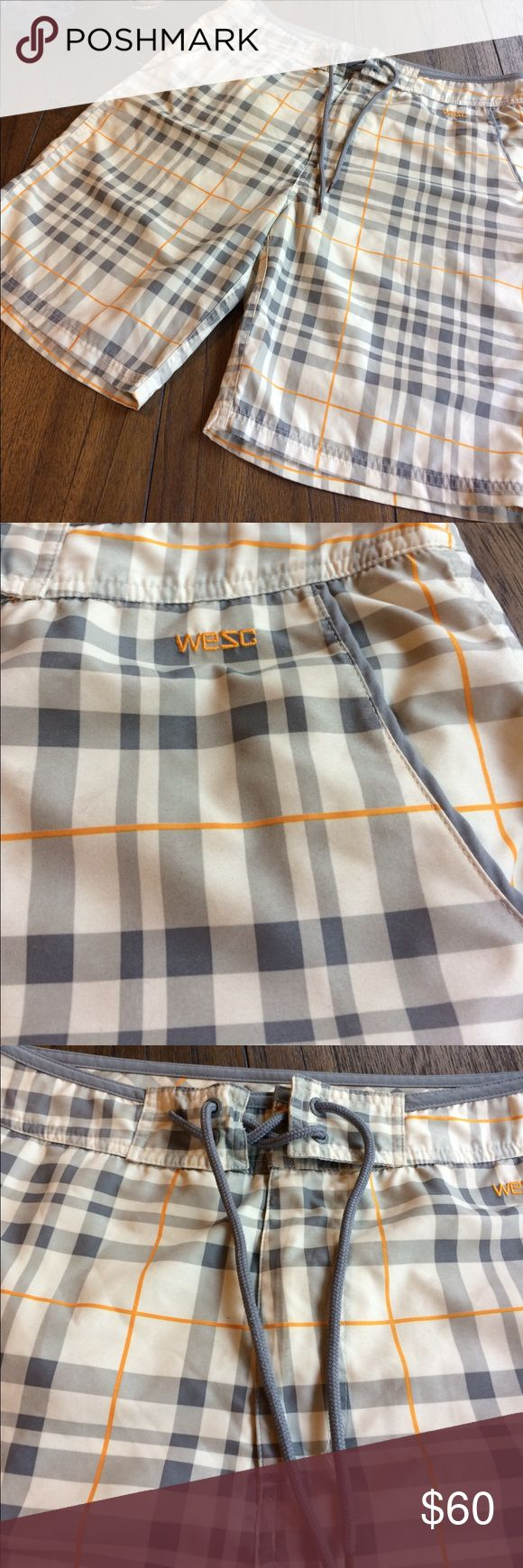 Wesc Board Shorts EUC--like new--never worn--WESC Board Shorts. Cream, grey & orange plaid pattern. Pockets at waist & Velcro slit pocket on the back. Has mesh inner brief to keep things in place. Zip fly with Velcro & tie. Interesting tie in that it comes through fabric & is stitched so you can't lose it--or your shorts while catching waves. Wesc Swim Board Shorts