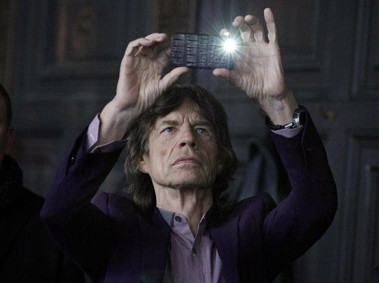 Mick Jagger with an iPhone