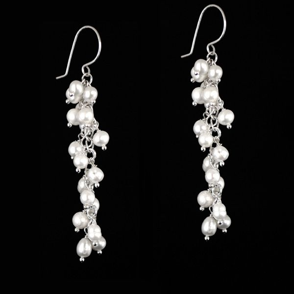 A long elegant waterfall of white freshwater pearls dangling on a sterling silver chain and set on sterling silver hooks.  Brionna will add grandeur to any occasion. A statement design that you will love to wear and keep.  These stylish earrings are also ideal for the modern romantic bride.