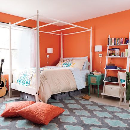 Vibrant orange pieces mixed with other bold-hued accessories, like a teal table and turquoise rug, give a room a playful, high-octane feel. For a more subdued and sophisticated space, choose just a few dark orange pieces and keep the rest of the elements neutral (white, cream, gray) to tone down the shade.