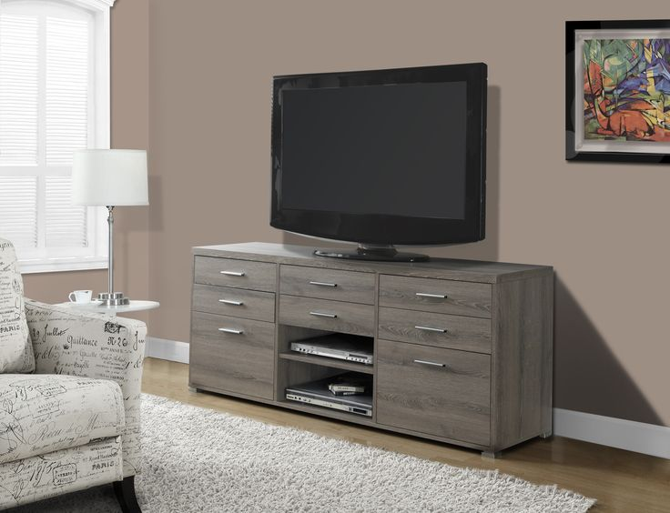Complete your home decor with the simple contemporary elegance of this dark taupe reclaimed wood-look TV console. Featuring 8 spacious storage drawers for your entertainment accessories and 2 open sto