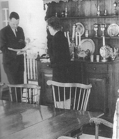 An aide reviews the President's schedule with the housekeeper in the President's House dining-room.