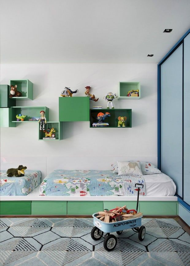 love the soft green + great layout: two beds on a white platform with storage under