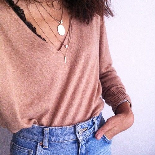 high waist jeans and layered necklaces