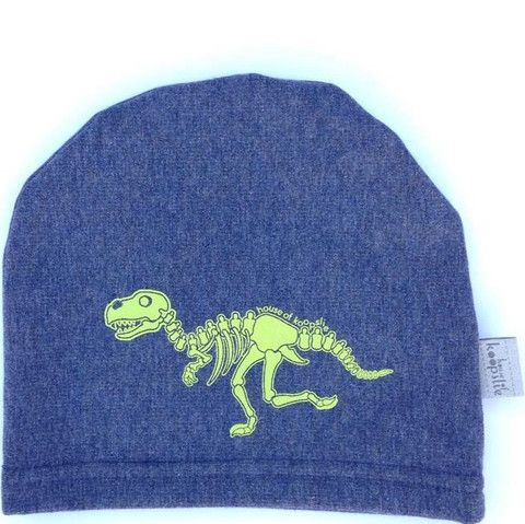 dino bones on heather blue: Our fleece-lined bamboo jersey, graphic print hat is a family favorite amongst the House of Koopslie community.  It is the perfect accessory for everyday wear, underneath a sports helmet or for family photos.  Our graphic hats are made out of our favourite fleece-lined bamboo blend – 66% bamboo, 28% cotton, 6% spandex and 100% awesome.