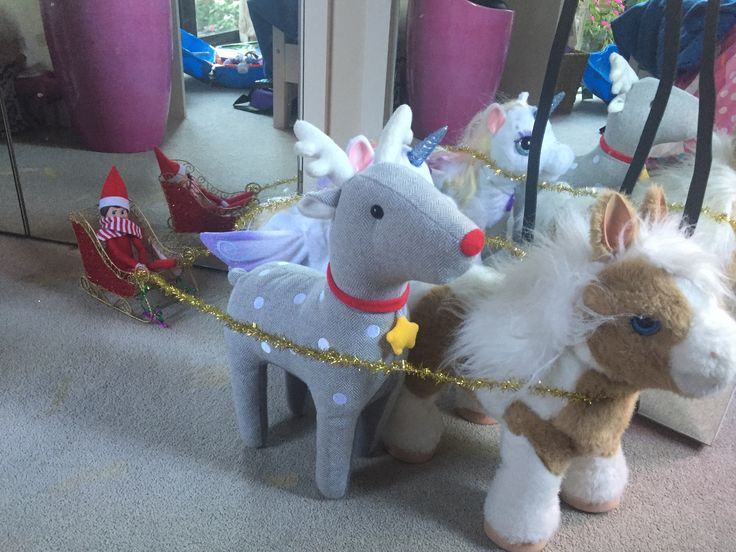 Sparkle the elf on the shelf playing with horses and reindeer and a sleigh 2016