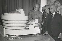 Frank Lloyd Wright, Hilla Rebay, and Solomon Guggenheim with a model of the building. Photo courtesy Solomon R. Guggenheim Archives, New York