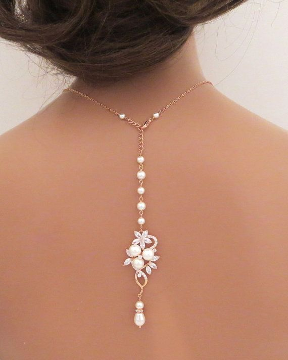 Exquisitely crafted Rose Gold bridal necklace or backdrop necklace glitters beautifully with clear Swarovski Pure Brilliance Zircons and just a