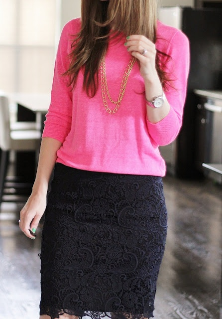 Black lace skirt with a pink dolman sweater. A bright business casual look.