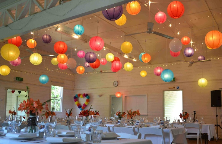 Ewingsdale Hall beautifully decorated with wreath & lanterns by Byron Bay Bunting, catering and coordination by Byron Bay Weddings.