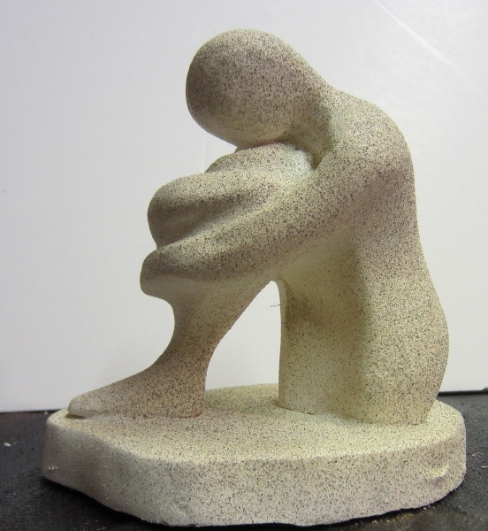SOLACE  This contemplative statuette of a deliberately isolated figure is made from alpha plaster and hand finished with a light speckled stone. £60