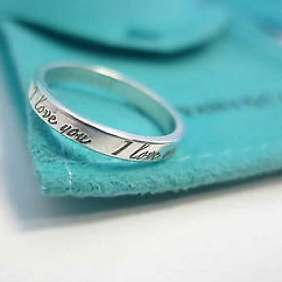 Gorgeous but simple dainty ring. Makes a great promise ring, or Valentine's Day present. Inscribe it says Tiffany and Co. Needs a good cleaning. Comes with Box, dust bag, ribbon, and shopping bag. Just like you purchased at store.