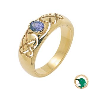 Our 18ct yellow gold Celtic ring with a pierced Celtic weave with an iolite gemstone set in the middle.