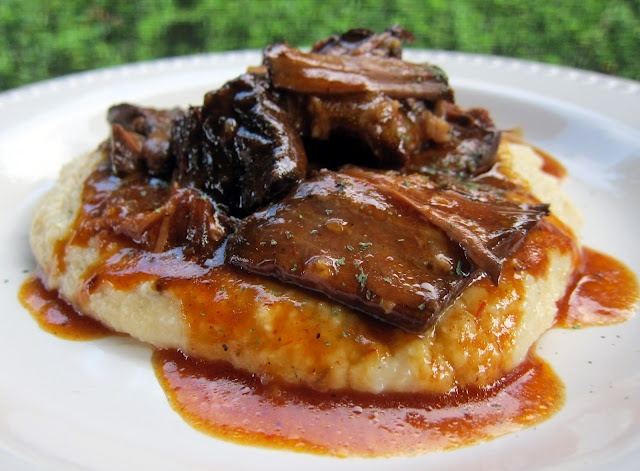 BBQ Pot Roast over Cheddar Ranch Grits. Uses slow cooker for the meat - even though it's called bbq. Does NOT use bottled bbq sauce!