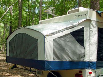 Solar covers are a must. They keep things cooler in the summer and warmer in the winter. Keeps tree and bird crud off the bunk ends as well as any water that may get on it not to mention they keep the inside darker in the early morning. Secured in place with Velcro under roof edge and clamped with small clips.