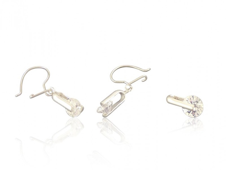 Silver jewelry set with white zircons