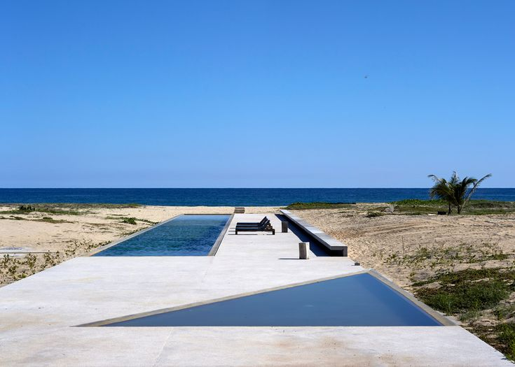 A 312-metre-long concrete wall provides the framework for this house and art centre designed by Japanese architect Tadao Ando on the Mexican seafront
