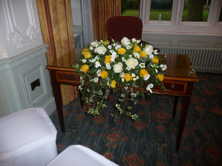 Yellow and White Registrars table arrangement