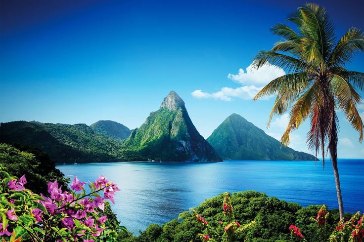 St. Lucia - Windward Islands * The twin volcanic peaks called the Pitons are such a distinctive feature of St. Lucia that they appear on the national flag.  During its colonial days, from 1635 through 1814, St. Lucia was developed as a sugar plantation , and France and England contested for control of the island--it was ruled seven times by each country before becoming an independent country in 1979.