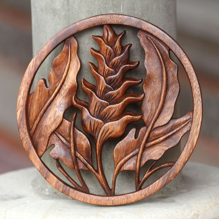 Nyoman Karsa captures the natural beauty of the heliconia for this hand-carved wall panel. Working in Balinese suar wood, he depicts the lovely leaves in a low relief wall sculpture.