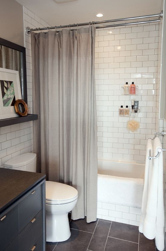Lovely small bathroom - Dark tile floor, subway tile shower, love the shelf above toilet. So cute! Do I pee in it or just look at it?.