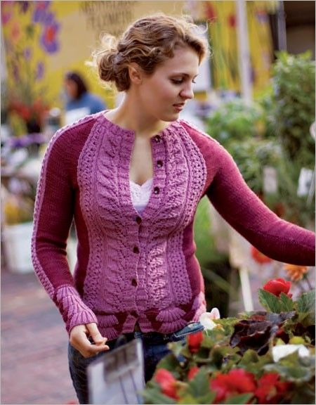 Laura Zukaite uses two shades of rose to accentuate the fitted lines of this unusual cardigan. Leaf motifs line the center-front edges, and a deep border of layered scallops, worked in intarsia, edges the body and the sleeves. The yoke is seamless; aft