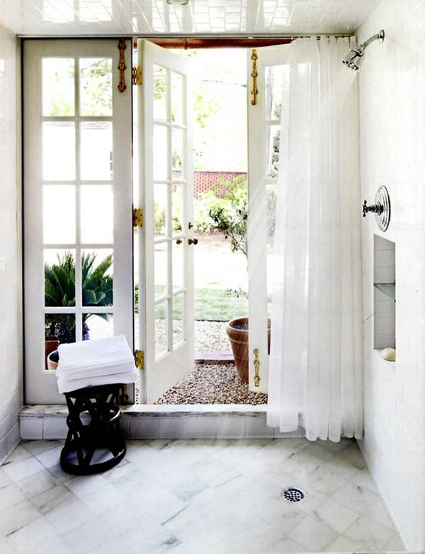 Wow!  What an amazing shower, with french doors that lead outside!  How romantic!  I want one, even though I wouldn't be able to stand more than about 10 seconds. :0(