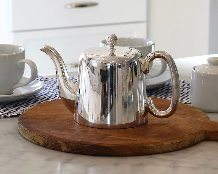 "This vintage HÔTEL Silver Teapot is the perfect 1 1/2 Pint English Teapot. It has a simple ball finial, a ""U"" handle with perforated holes to prevent the hot wa"