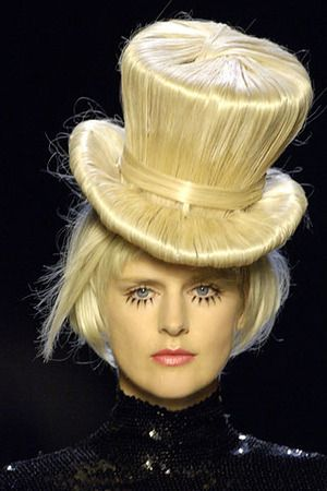 Jean Paul Gaultier's Fall 2006 collection.  The hats were made of hair.