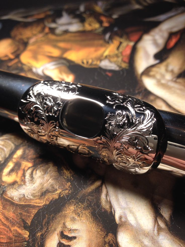 Engraved flute embouchure