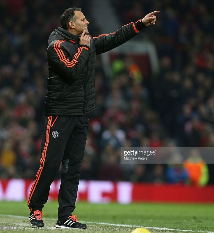 Assistant Manager Ryan Giggs of Manchester United watches from the touchline during the UEFA Europa League Round of 16 Second Leg match between Manchester United and Liverpool at Old Trafford on March 17, 2016 in Manchester, United Kingdom.