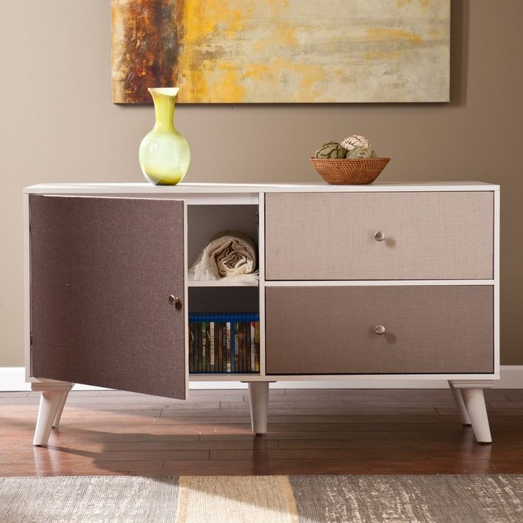 SEI Colorblock Anywhere Storage Cabinet/Console - Linen HZ1081 - SEI Colorblock Anywhere Storage Cabinet/Console - Linen HZ1081Mix it up and keep it looking fresh with this unique colorblocked console. Distinctive linen covered cabinet and drawer fronts provide depth and texture for an eclectic look, while the neutral earth tones fit any color scheme. With an open display top, two spacious drawers, and a shelved cabinet, this piece has plenty of storage space for all of your extras. Make…