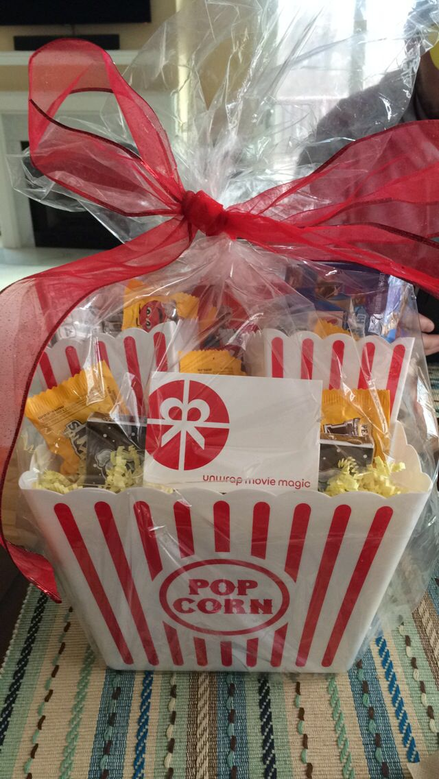 Movie themed gift basket - super cheap! Everything except the gift card for less than $1!  -Movie theatre/Redbox gift card - Large popcorn bucket - 2-pack small popcorn buckets  - Box of movie theatre popcorn  - Fun- and movie- sized candies (I chose fun M&M's, Sno Caps and Bunch-a-Crunch) - yellow decorative shreds  - cellophane and bow to finish
