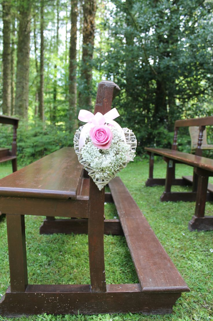 Pew end of wicker heart, pink rose and baby's breath