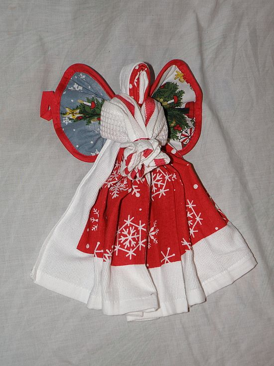 kitchen angel : Poem::: Enjoy me for a little while, until I go out of style. Snip a ribbon here & there. Take apart with gentle care.----------------made with One pot holder (wings), 1 kitchen towel (angel), 1 kitchen wash cloth ( angel arms). Held together with ribbon.