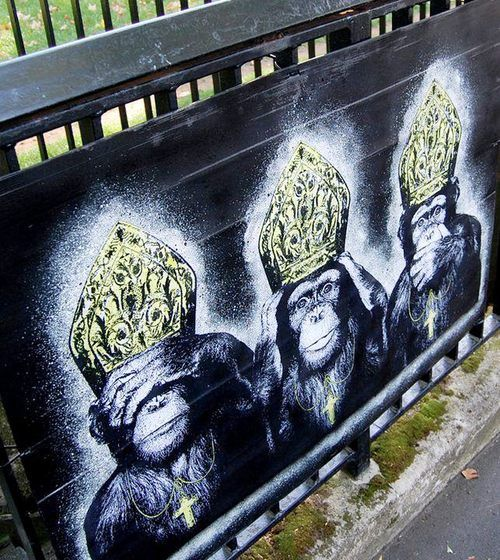 A three wise monkeys stencil protesting against the Catholic Church's treatment of child abusing priests.